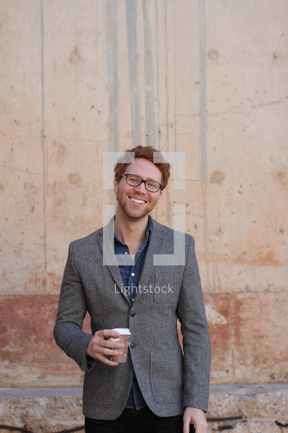 Young man holding coffee cup