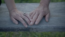 a couple touching hands