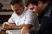 men in a discussion at a Bible study