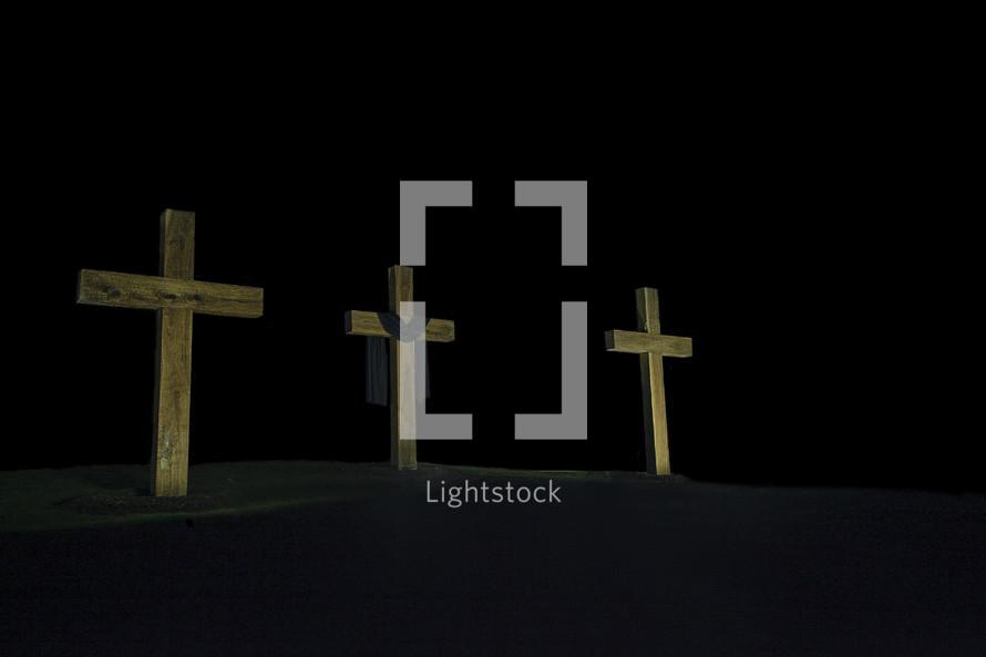 tree crosses in darkness