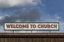 Welcome to Church sign on the roof of a building