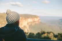 Woman looking out over a canyon.