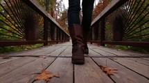 leather boots walking on a wood deck