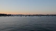 boats in a harbor in Boston at sunset
