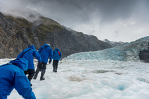 hikers on a glacier