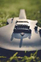 a guitar in the grass