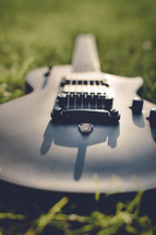 a guitar in the grass