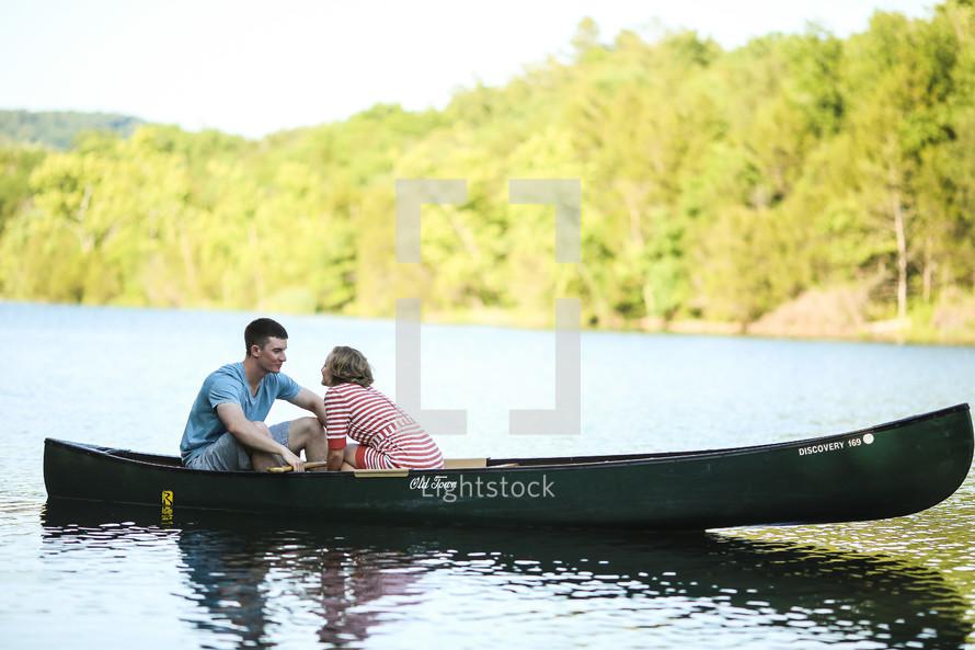 A couple talking in a canoe