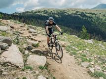 mountain biking down a slope