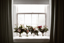 bridal bouquets in a window sill