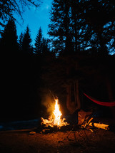 hammocks by a campfire