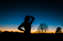 silhouette of a teen girl at dusk