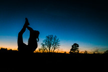 silhouette of a girl stretching