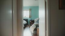 walking down a hallway into a bedroom
