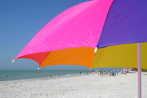 beach umbrella and a crowded beach