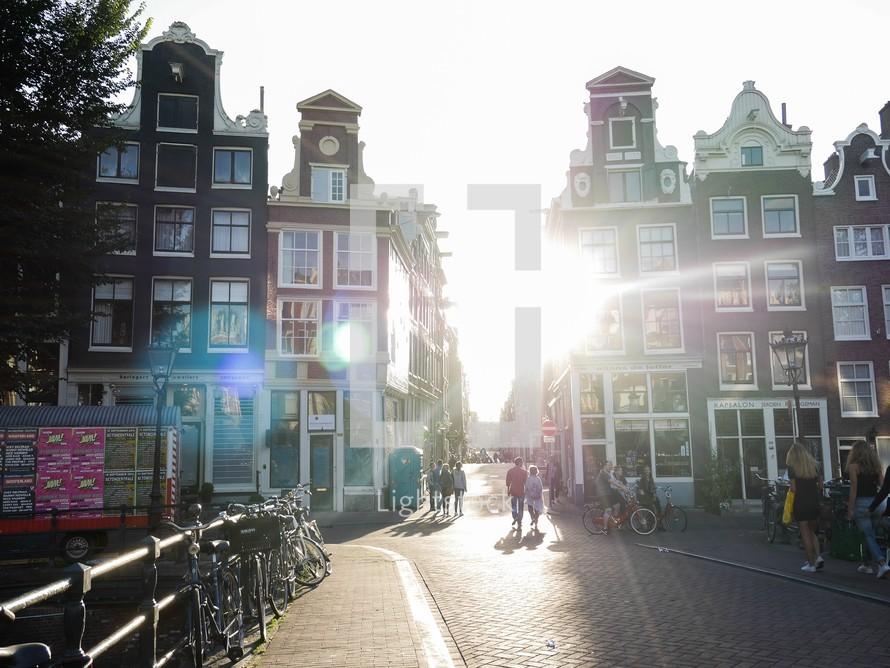 sunburst between buildings in Amsterdam, Netherlands