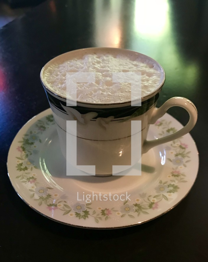 frothy coffee cup
