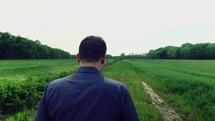 man walking on a path