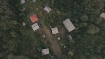 Aerial flyover of mountain village in Papua New Guinea, perfect for missions trip promo video.