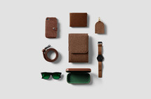 brown leather items on a white background
