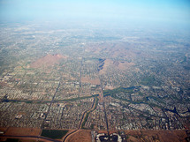 An Aerial Bird's eye View over the city of Phoenix, Arizona taken from an air plane in the southwestern United States.