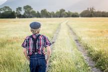 a boy walking in a field