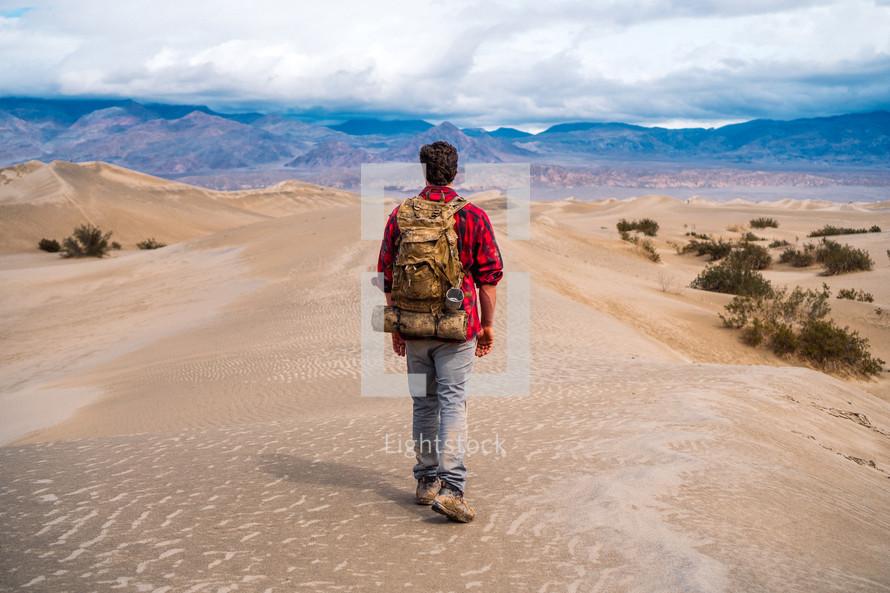 man hiking through the desert