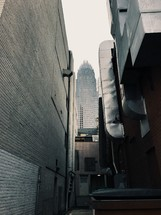 back alley and skyscraper view