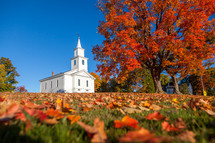 rural church surrounded by fall leaves