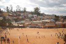 dirt sports field in a village
