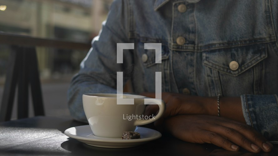 a man drinking coffee in Gothenburg, Sweden