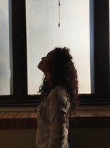 a woman looking up to God