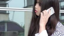 teen girl talking on a cellphone