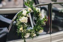 floral wreath on a car window