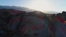sunbeams on a rocky landscape
