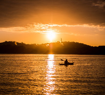 kayak on the water at sunset