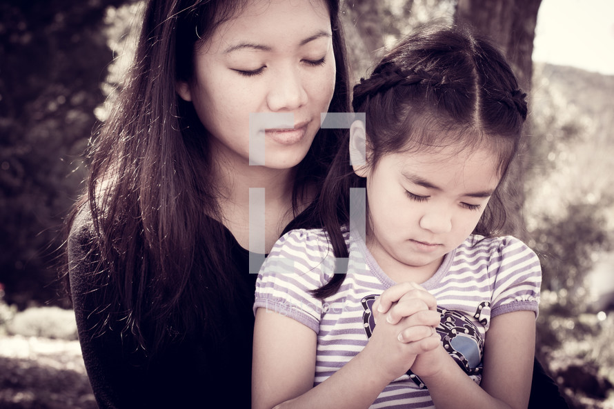 mother and daughter in prayer