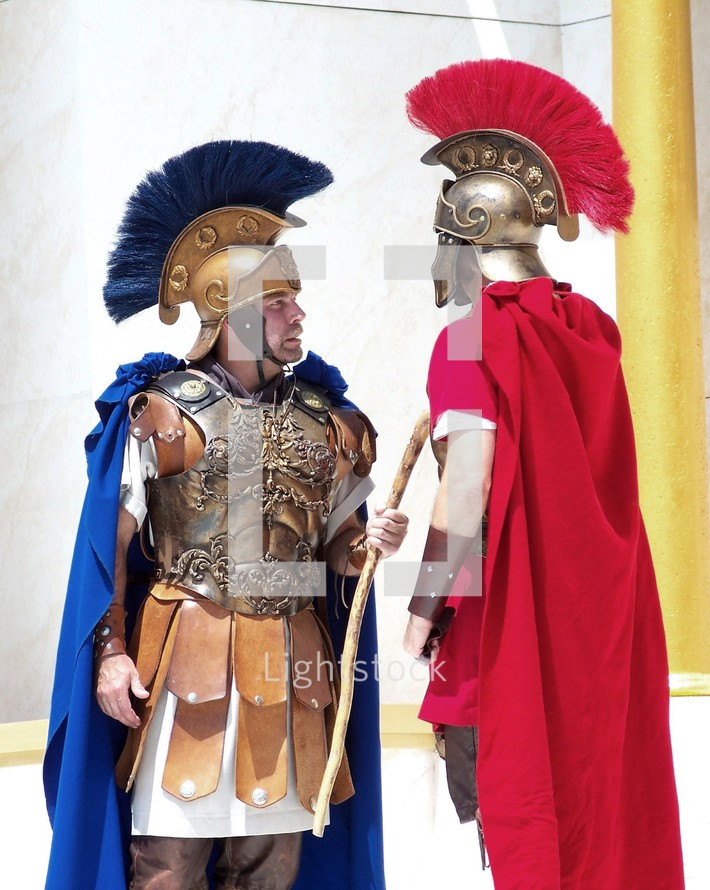 Two Roman Soldiers meet to discuss orders in a courtyard in old Jerusalem.