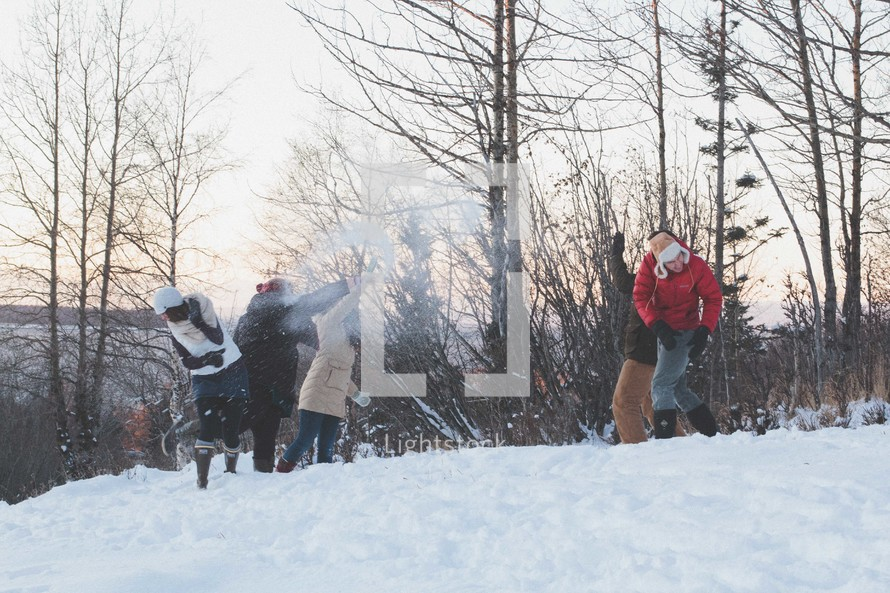snowball fight in winter snow