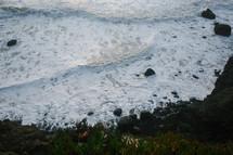 sea foam along a shore