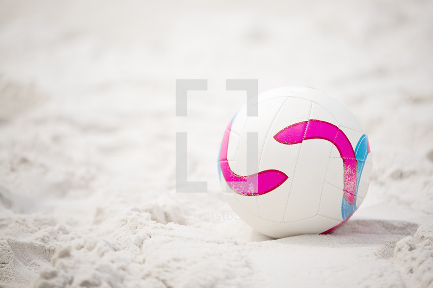a volleyball in the sand