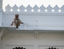 a man painting a building in India