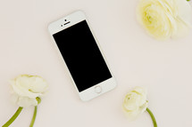 iPhone and white flowers