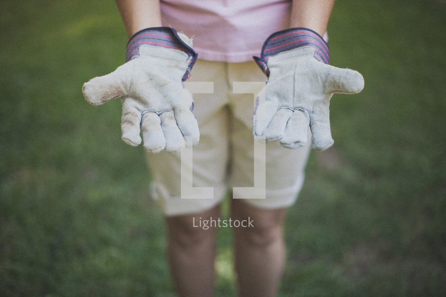 woman in work gloves