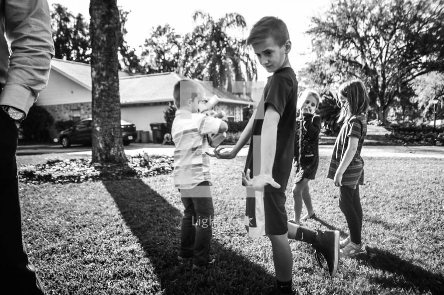 kids playing in a backyard