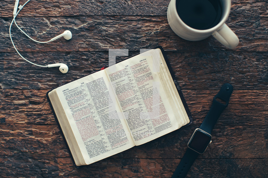 earbuds, smartwatch, Bible, and coffee cup