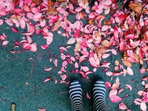 rain boots and fall leaves