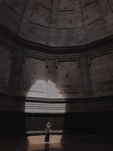 a woman standing under a dome