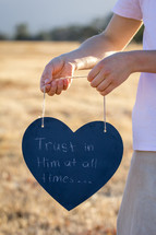 Trust in Him at All Times Written on Chalkboard