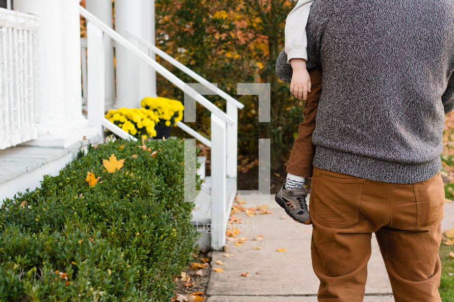 Dad carrying son fall colors